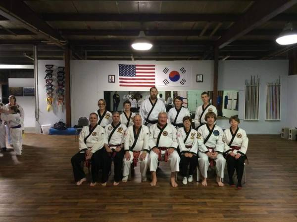Black Belts, Masters, and GrandMaster after evaluating a test
