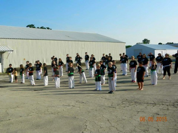 Traditional Karate Club students performing 1,000 kicks to donate pledges to charity
