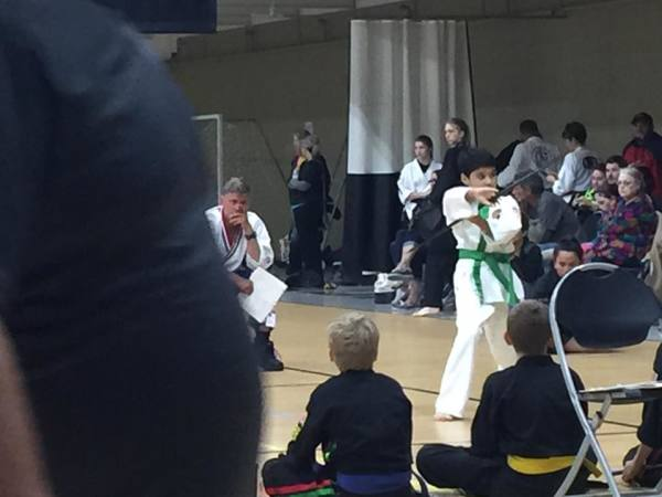 Traditional Karate Club of Cascade student performing a bo staff form for judges at competition