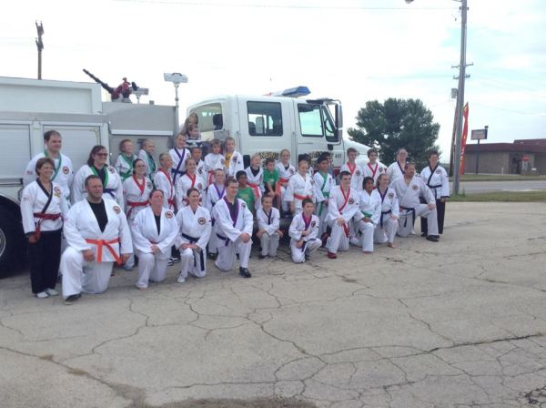 Cascade Karate members with Fire Truck after performing 1000 kicks for new fire equipment