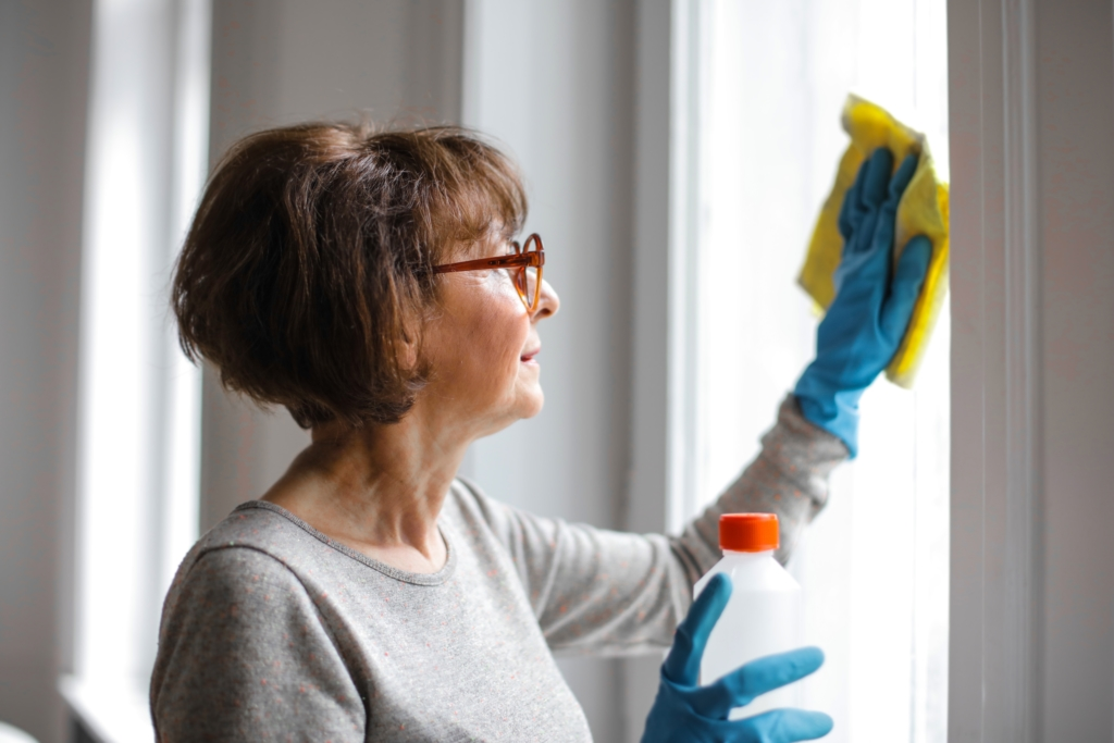 woman cleaning her Airbnb for post-Corona travel