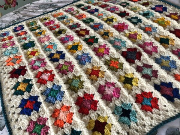 Colourful-Cuddle-up-Crochet Granny Blanket - main product image