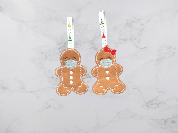Gingerbread with face mask christmas decoration - main product image