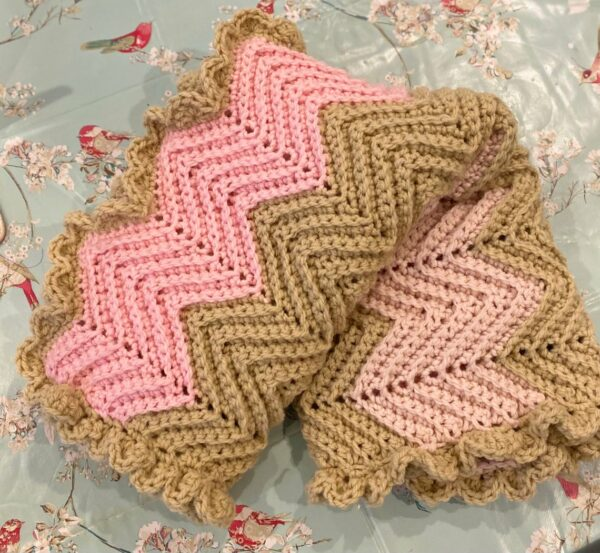 Chevron Crochet Baby Blanket in Pale Pink, Mid Pink and Soft Cream with Ruffle Boarder - main product image