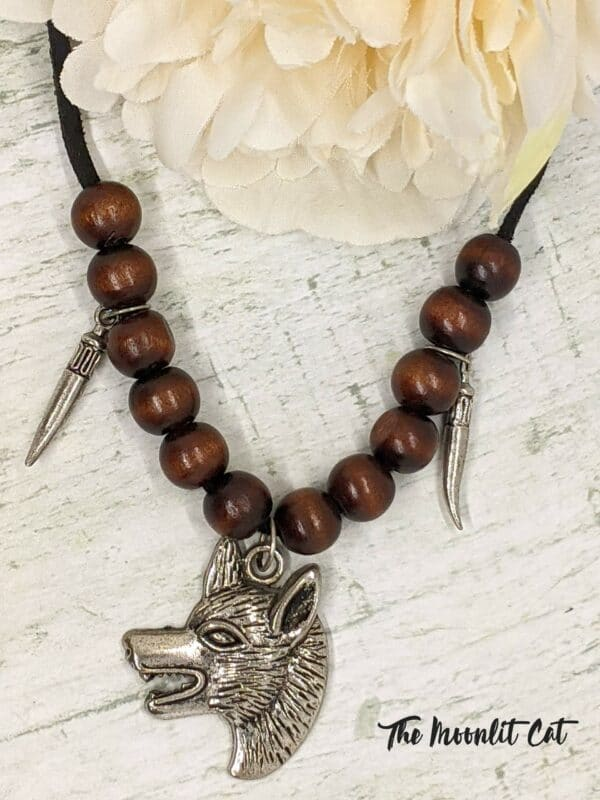Faux Suede and Wood Bead Necklace with Pewter Wolf Head Pendant - product image 2