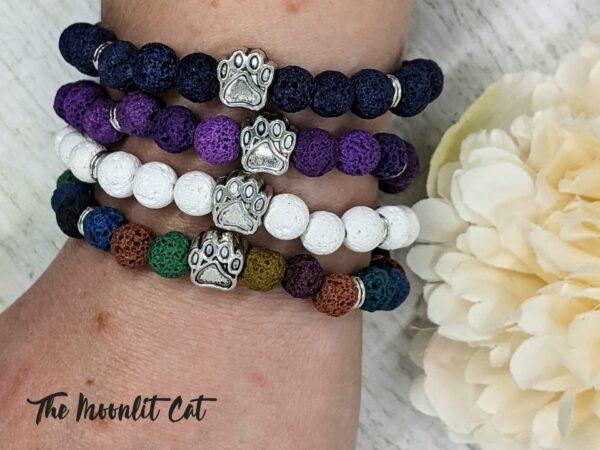 Dyed Natural Lava Stone Paw Print Bracelet - main product image