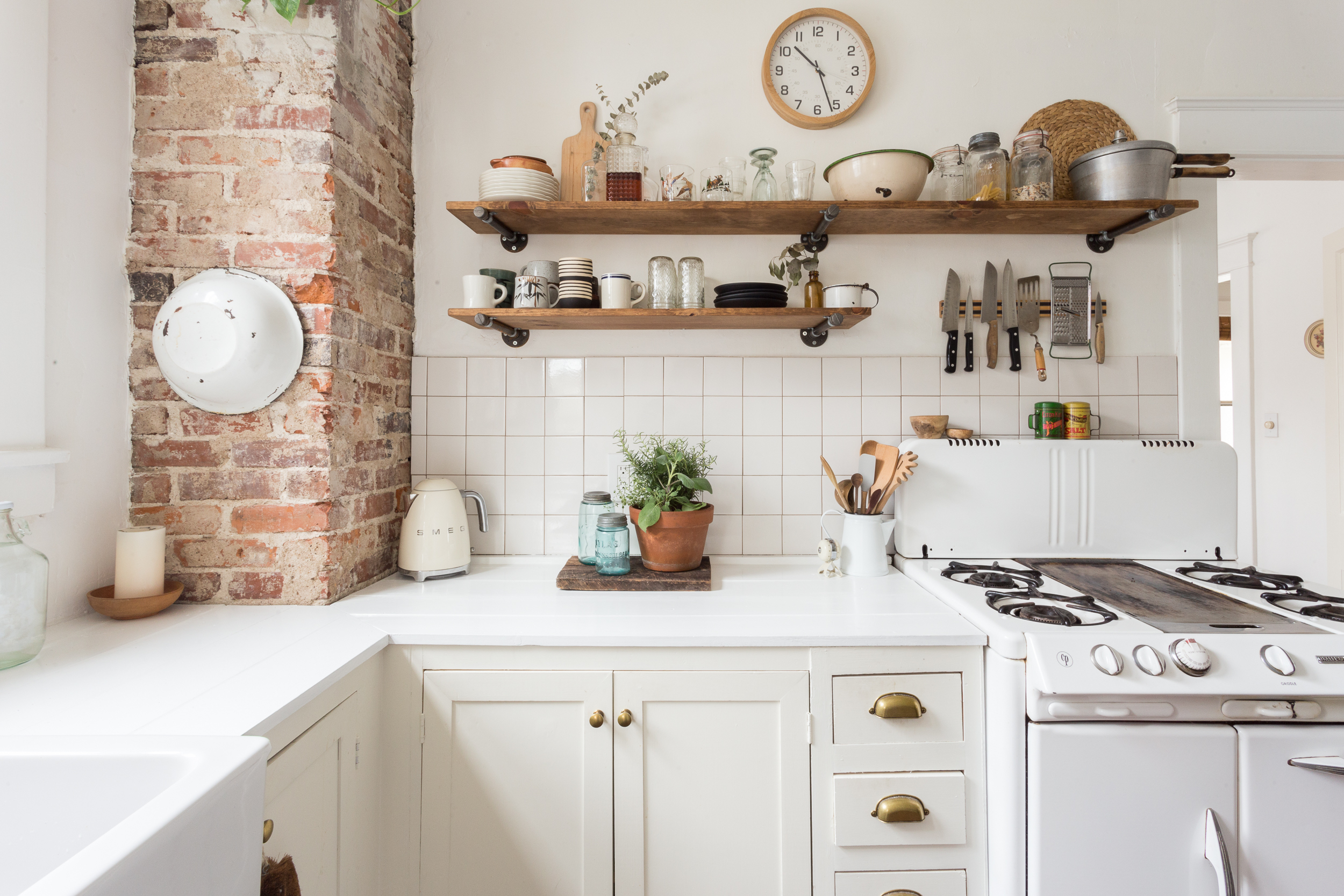 Open Kitchen Shelving Advice & Secrets | Apartment Therapy on decorating tips above kitchen cabinets, interior decorating above kitchen cabinets, wasted space above kitchen cabinets,