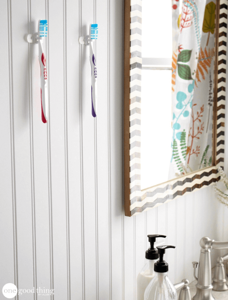 How To Use Adhesive Strips To Organize Your Bathroom