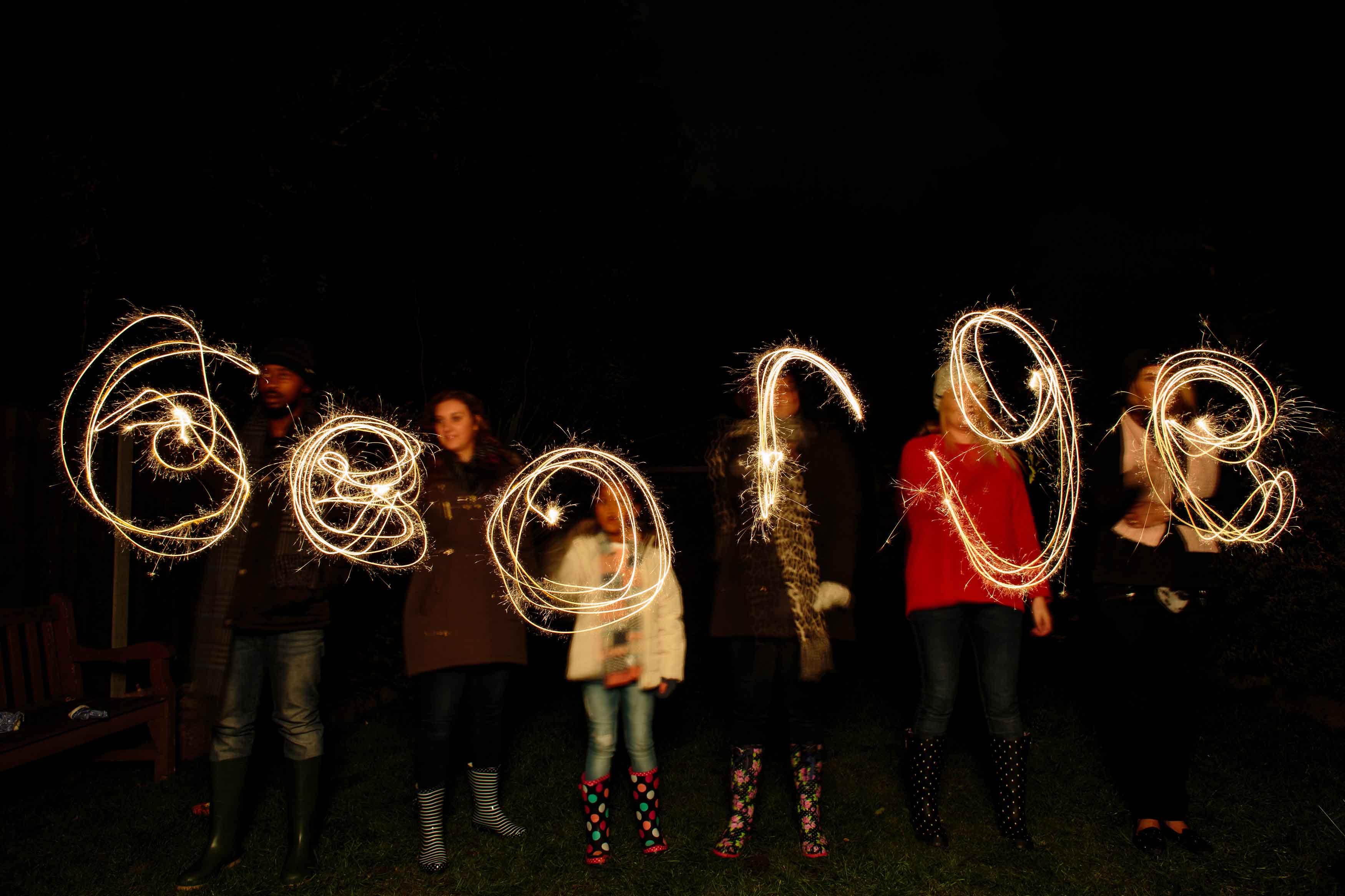 Family writing with sparklers for Bonfire Night