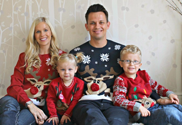 Family of four in novelty jumpers