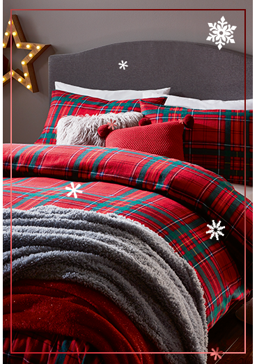 Wake up on Christmas morning in a cosy tartan-themed bedroom