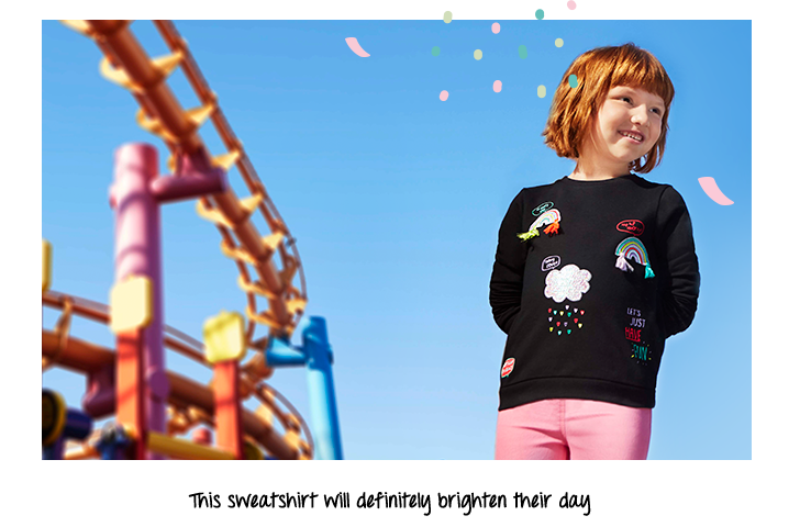 This sweatshirt comes designed with an iridescent sequin cloud raining hearts, a tassel trim glitzy rainbow and more