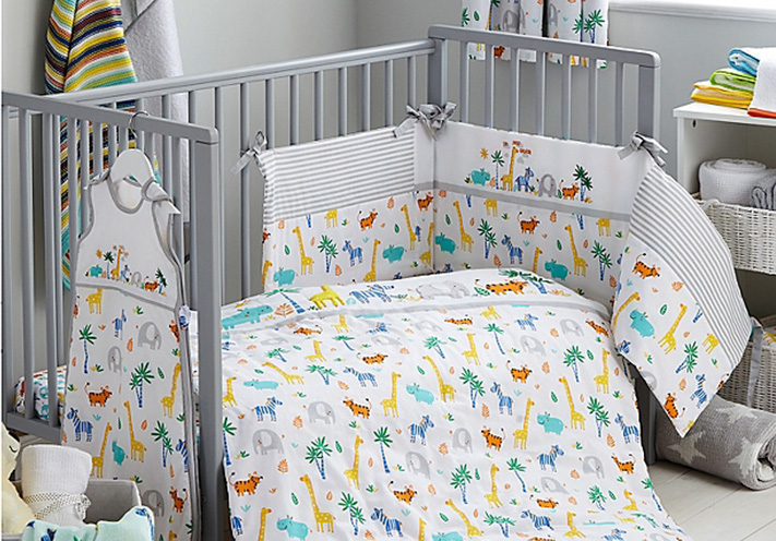 Cot with safari print bedding
