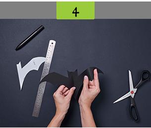 Folding black card to create bat