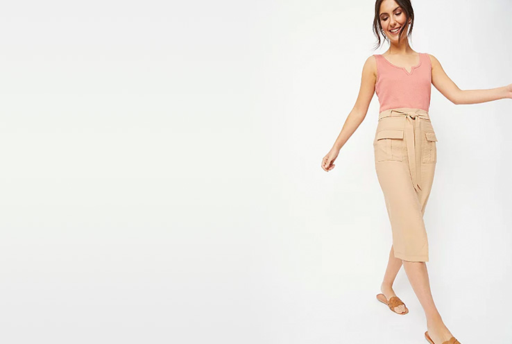 Team a beige utility skirt with a textured dusty pink top