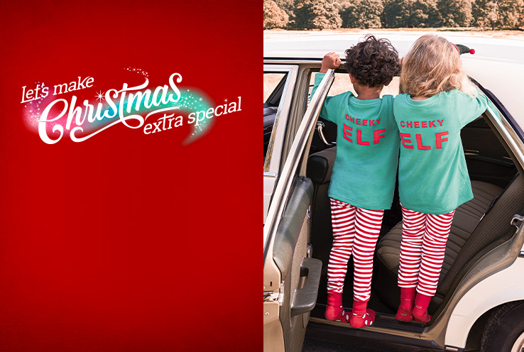 Two children standing in a car wearing identical green tops with 'Cheeky elf' slogan and matching striped bottoms