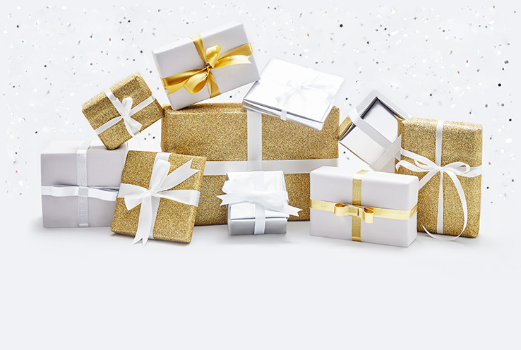 Assortment of presents in gold, white and silver wrapping paper and bows