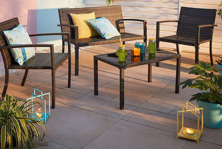 Relax outside with this stylish patio set which includes one table and three chairs
