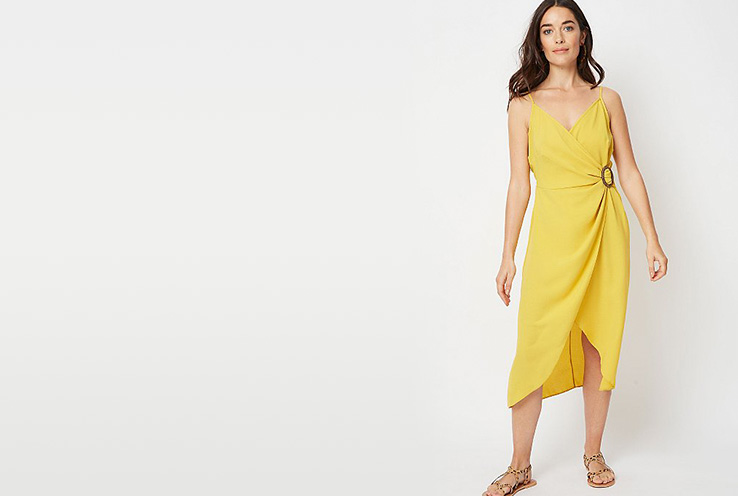 In a wrap style, this bright mustard-coloured midi dress features a ring detail at the waist and a flattering V-neck