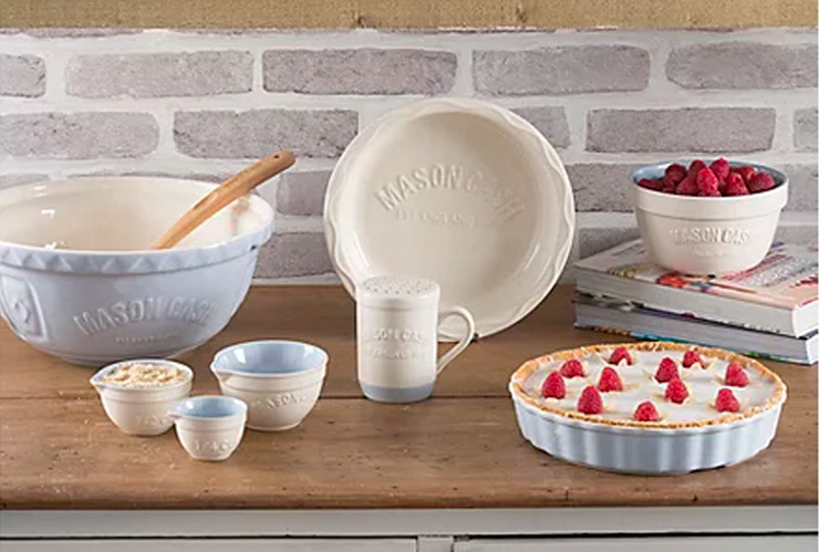 Baking set on a table, including mixing bowl, spatula, plate and bowl