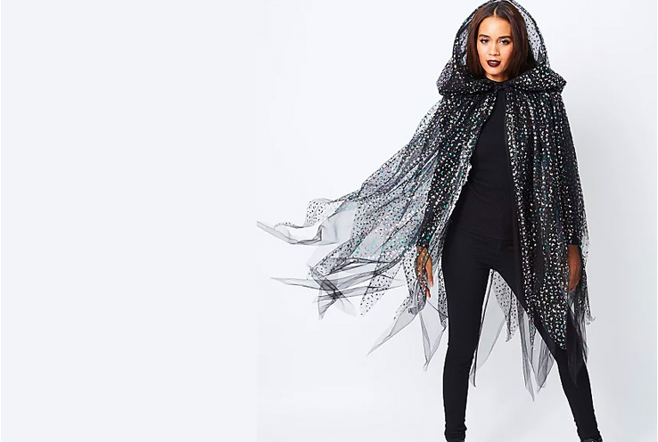 Woman wearing George star and moon print hooded cape Halloween costume