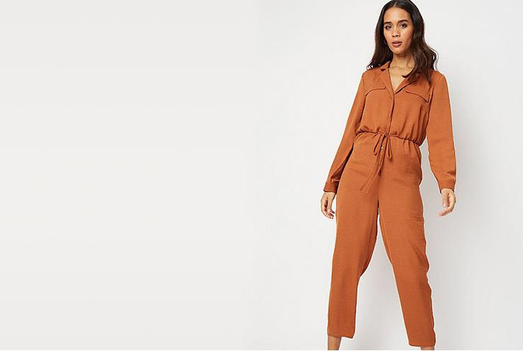Woman wearing an orange boiler suit