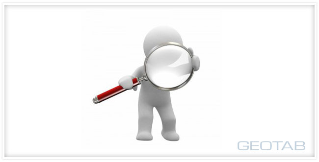 A white figure holding up a magnifying glass