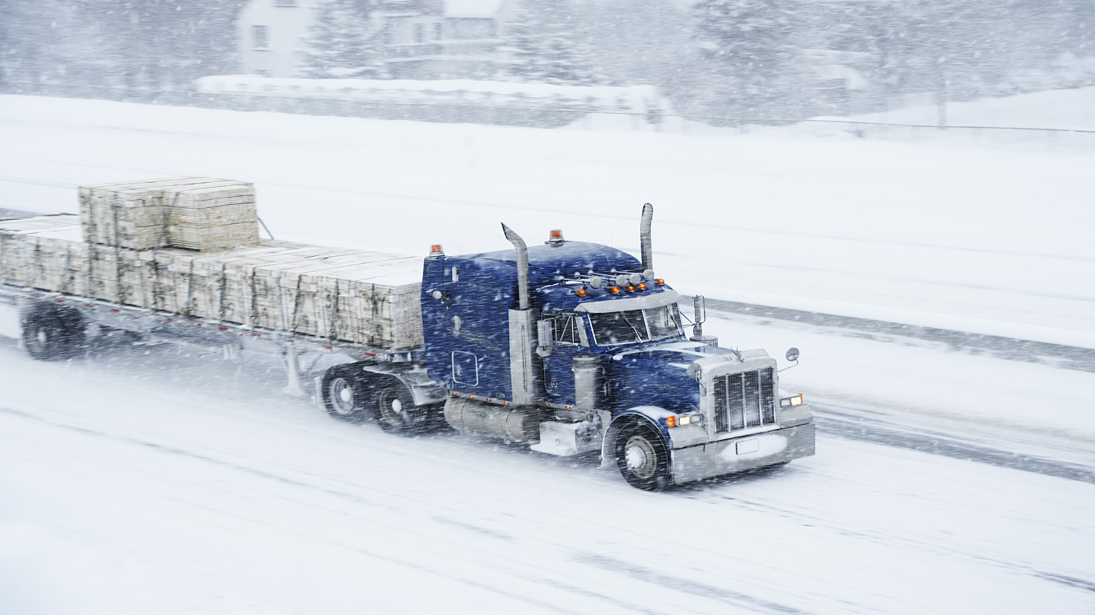 A truck driving through a blizzard