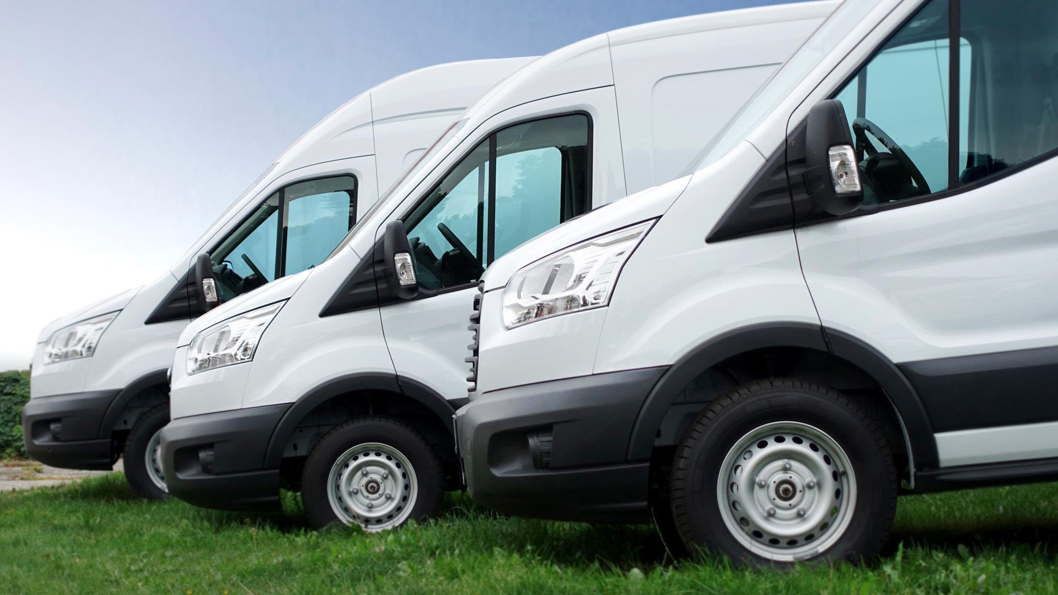three white parked vans