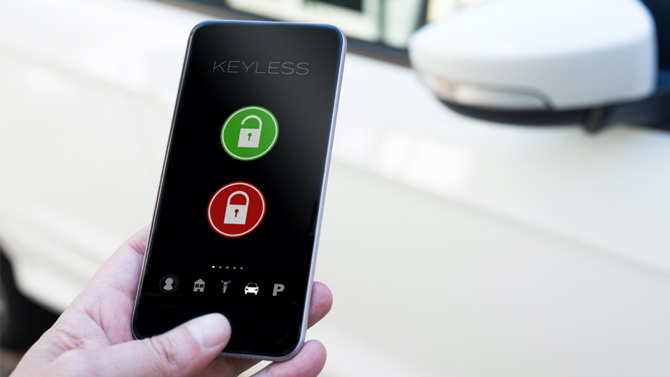 Hand holding a smartphone activating a keyless motorpooling solution