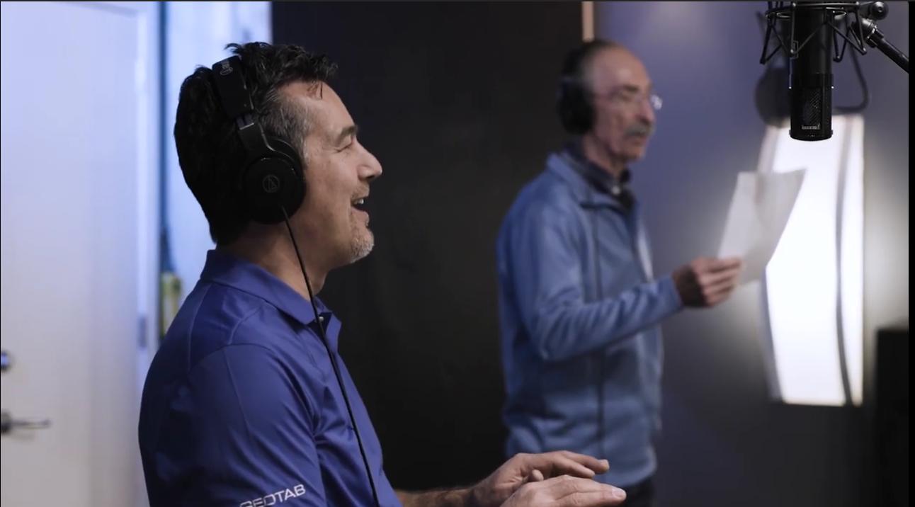 Two Geotab employees singing