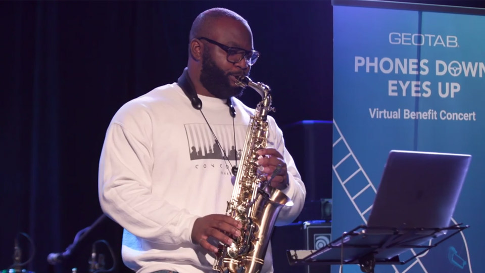 Saxophone player at the Phones Down, Eyes Up live concert