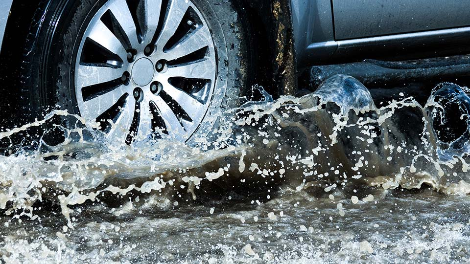 Wheels of a truck splashing water