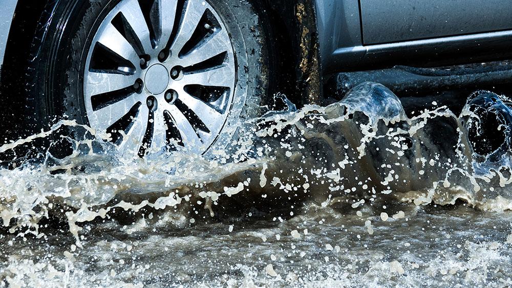 Wheels of truck splashing water