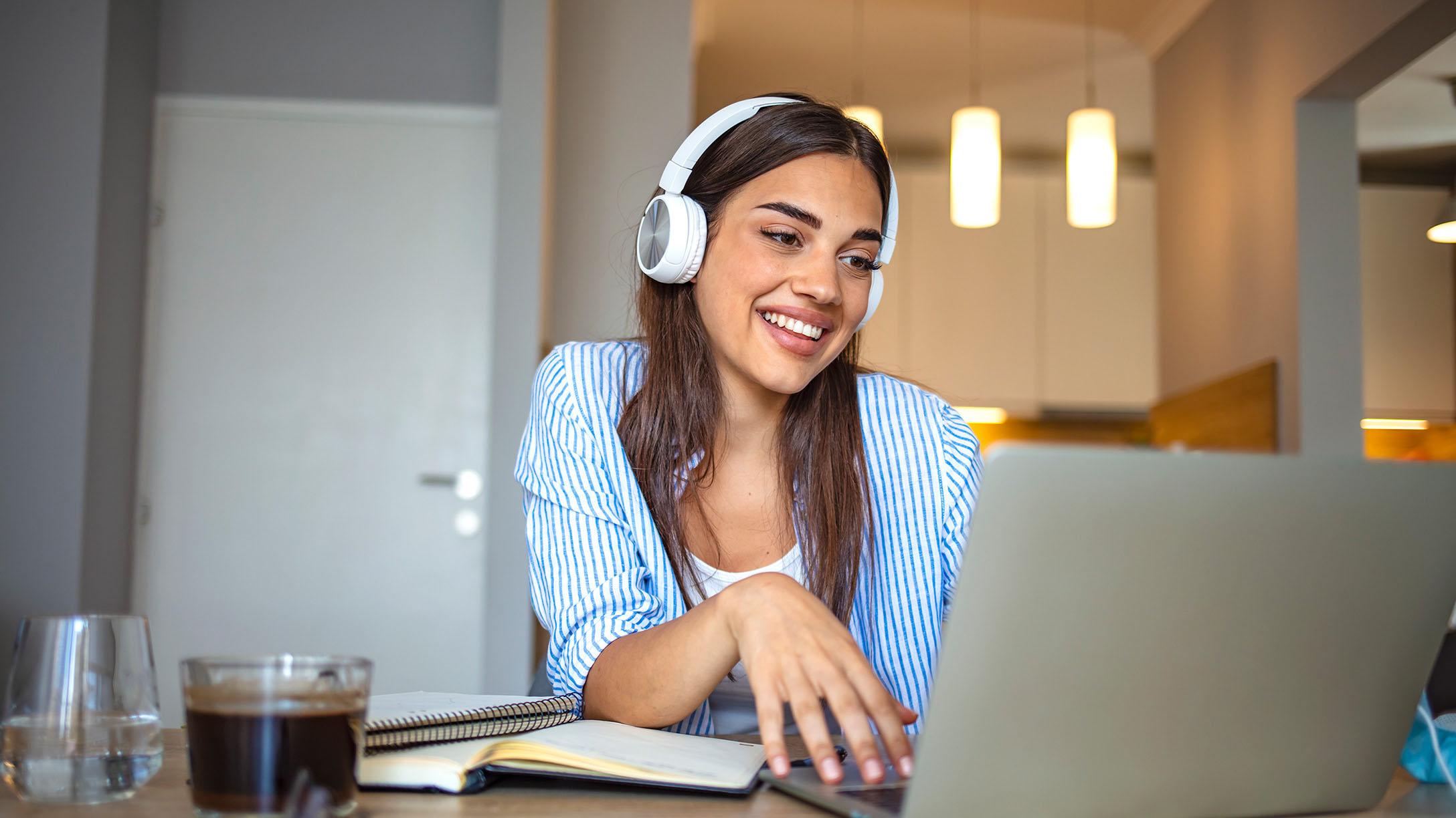 Girl smiling on computer
