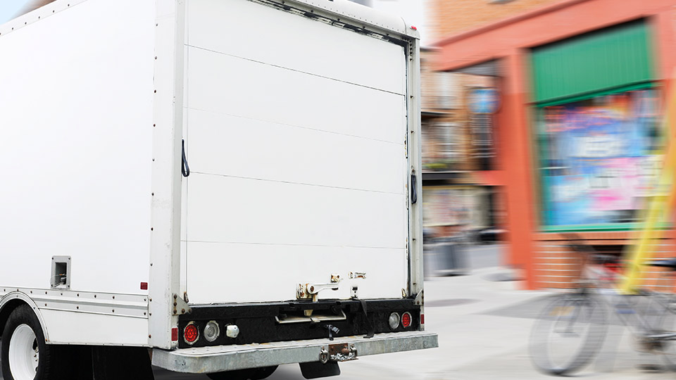 A delivery van carrying goods