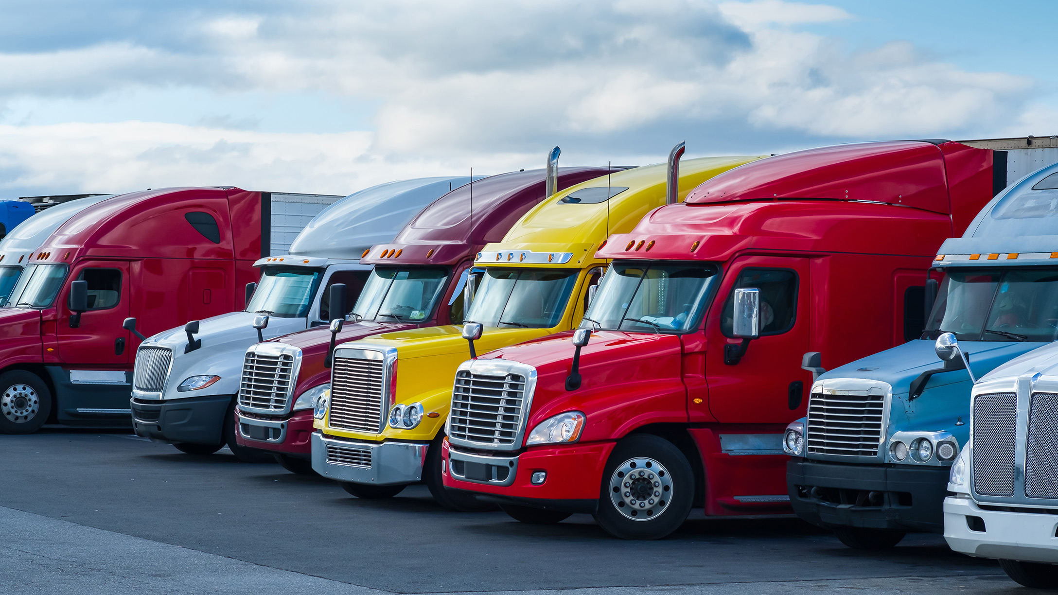 Colourful trucks standing together
