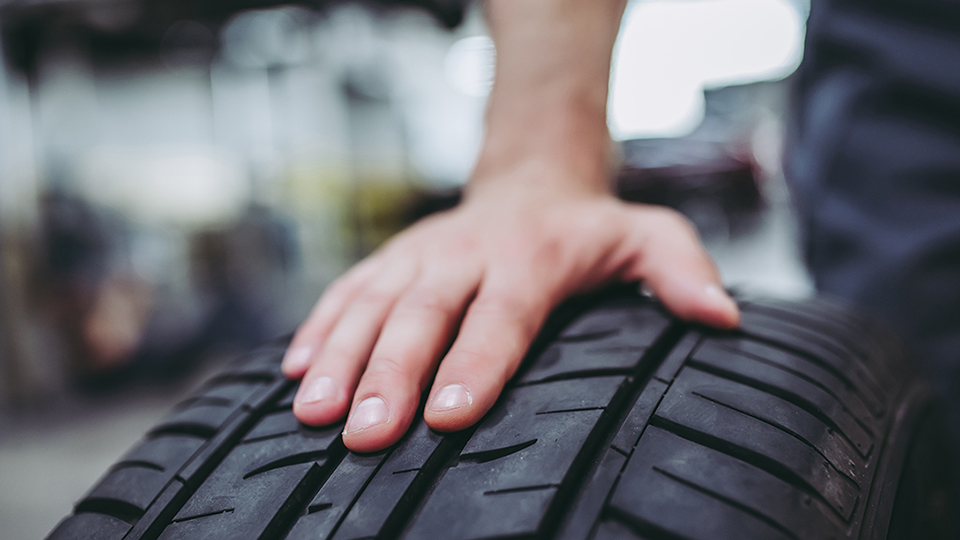 A hand on the tire