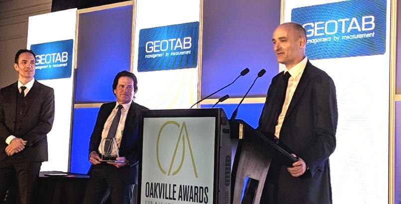 Neil Cawse standing at a podium
