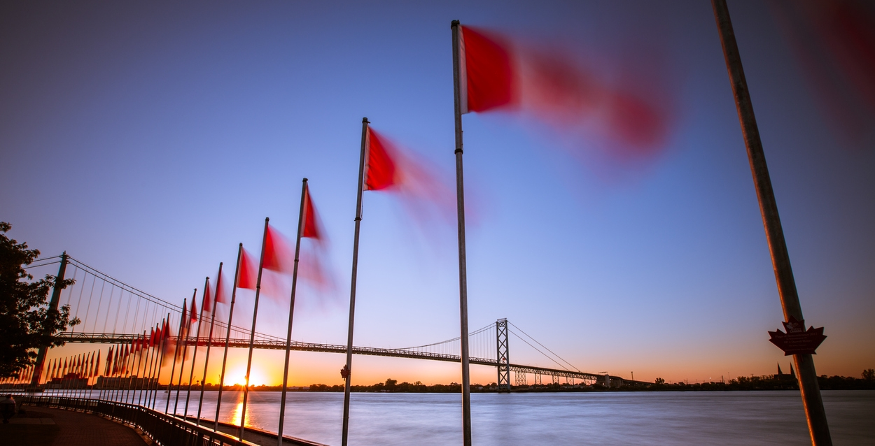 A row of Canadian flags blurred from movement