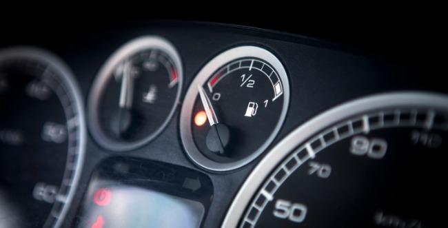 A closeup photo of the fuel gauge of a car