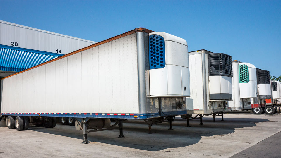 A row of trailers at a loading dock