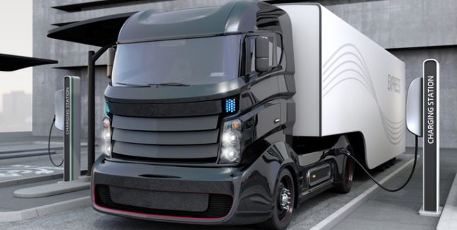 Concept image of electric truck parked at a charging station