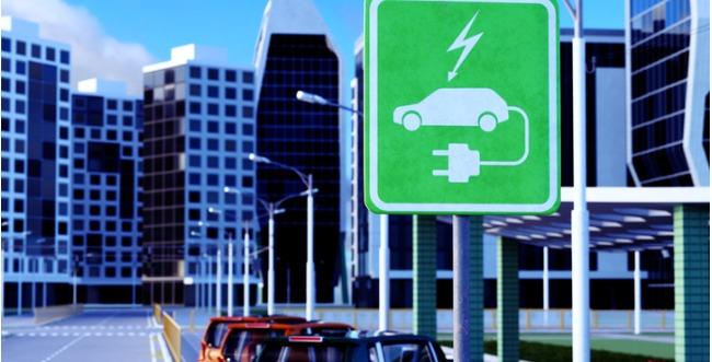 Señal con indicación de cargador de coche eléctrico