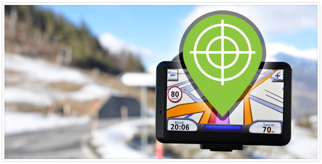 A GPS device with a target notification on the screen and a road in the background