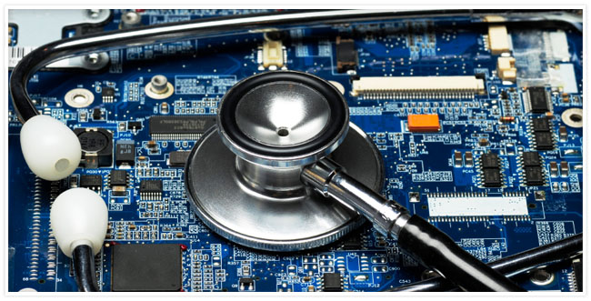 A blue circuit board with a stethoscope on it