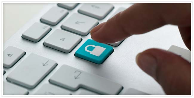 A white keyboard with a hand about to press a teal key with a padlock on it