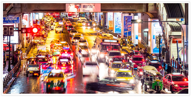 A busy road full of traffic in Asia with a long exposure effect on the photo