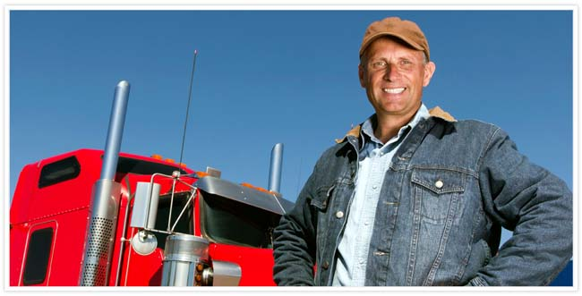 A man posing in front of a red semi truck