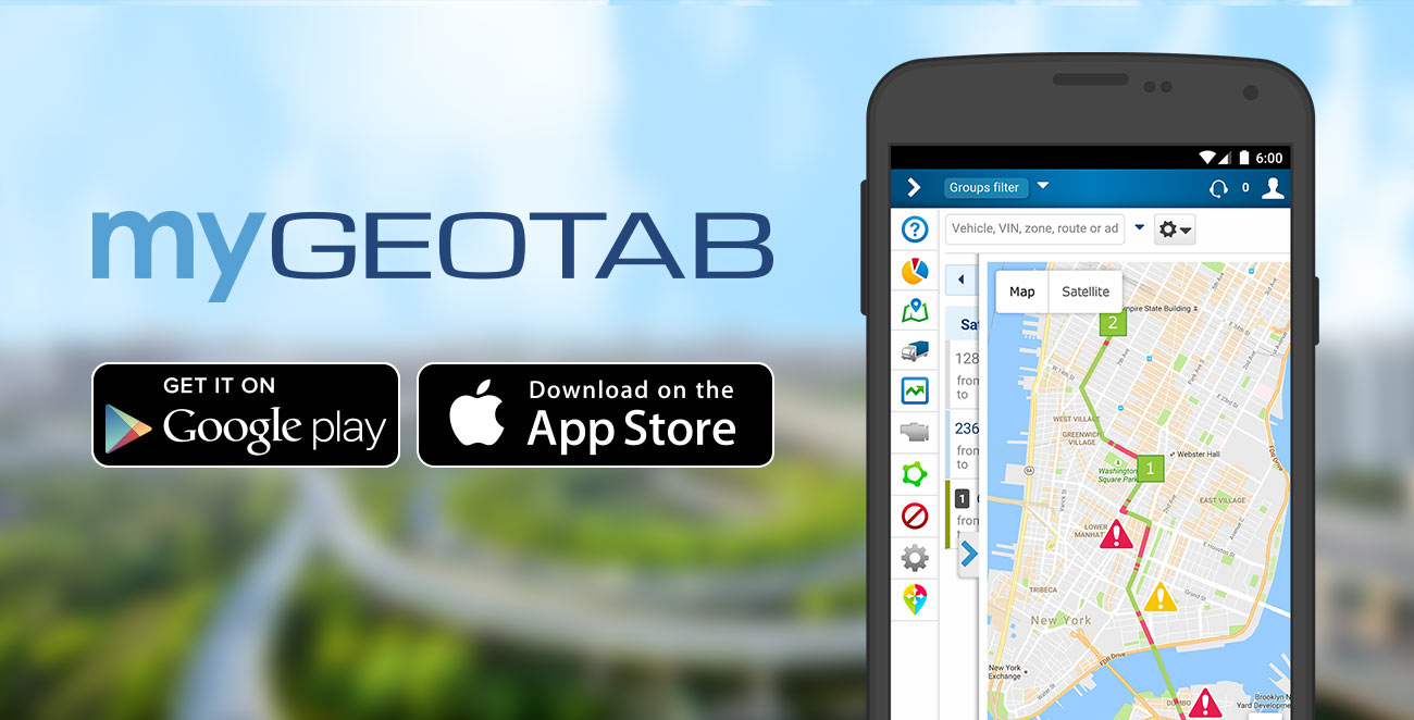 A black android phone with the MyGeotab app open and blurry highways in the background